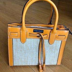 Kate spade woven purse with orange trim